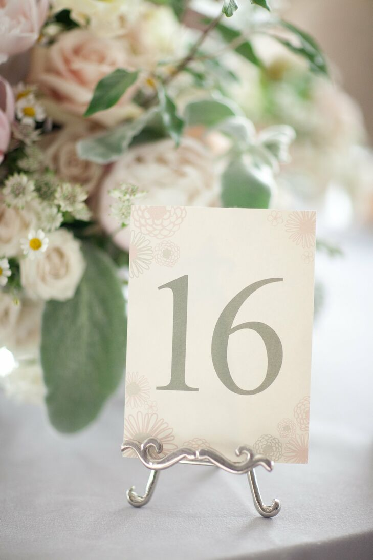 The table numbers had the same pastel floral motif as the couple's invitations.
