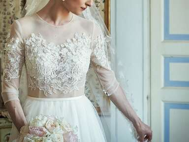 Winter wedding dress with floral and lace embroidered three quarter sleeves