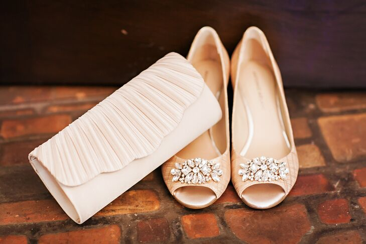 5902b43578 Champagne Wedding Shoes and Ivory Clutch. Favorite. Erin s accessories were  simple and fun. She paired her classic white lace ball gown with