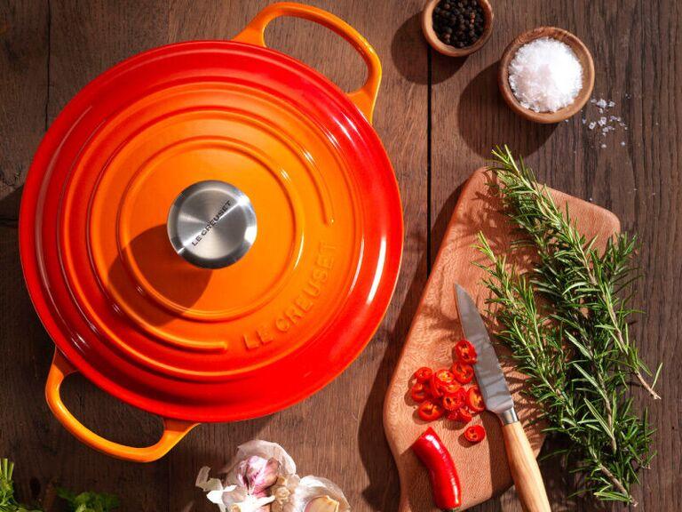 Cast iron Le Creuset Dutch oven in bright orange color