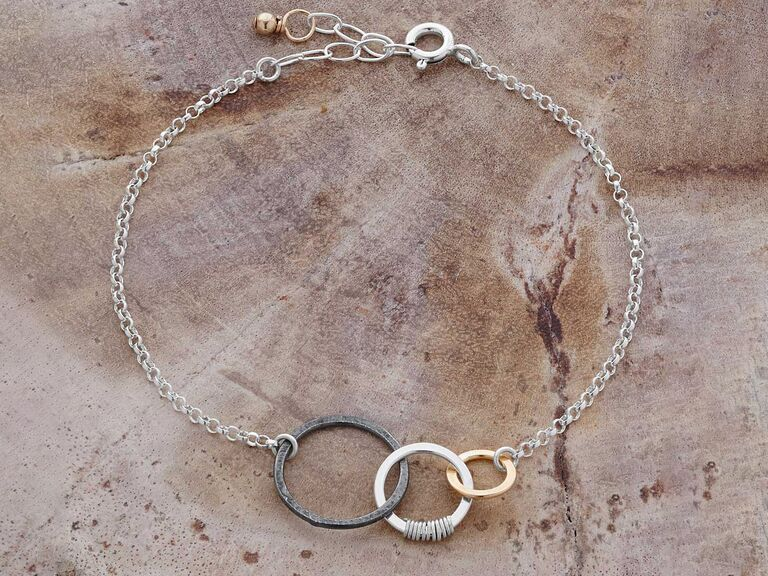 Unique silver bracelet with past, present and future interlinked rings
