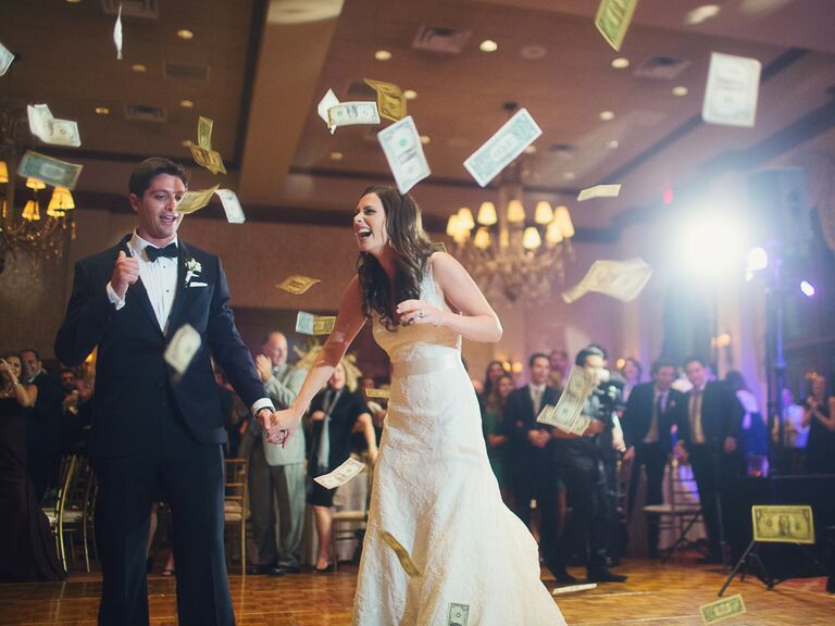Bride and groom doing the money dance at their wedding