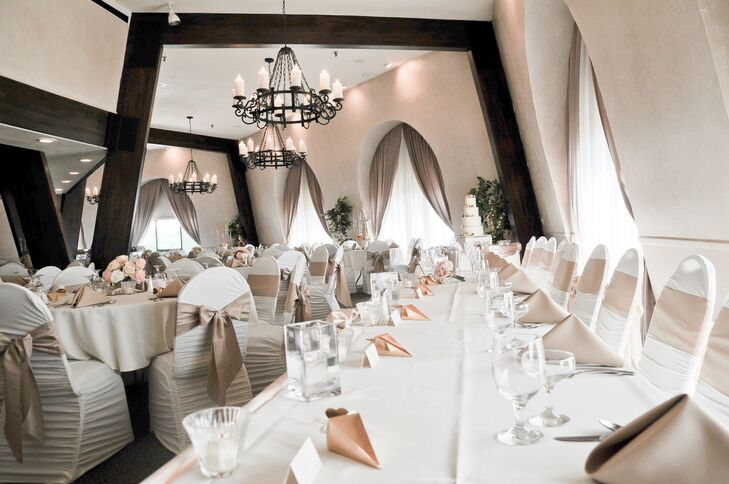 With unique architecture, the Swan Valley Golf and Banquet Center utilized its grand chandeliers to help fill the high ceilings alongside the high floral centerpieces. With 10 block candles circulating each chandelier, the cherrywood arches glowed and light shined off the champagne and blush linens.