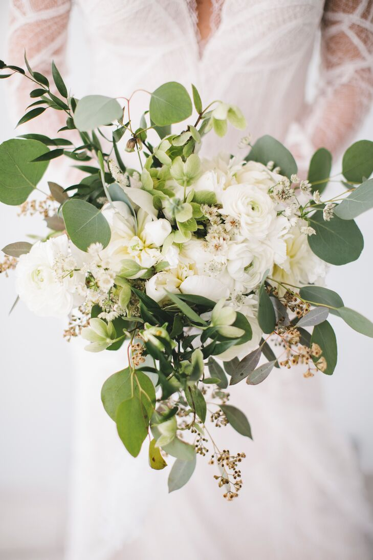 "Bouquets and boutonnieres were created using white blooms, like anemones and sculptural greenery. ""We wanted to stay away from any bright colors and keep it as simple and clean as possible,"" Amanda says."