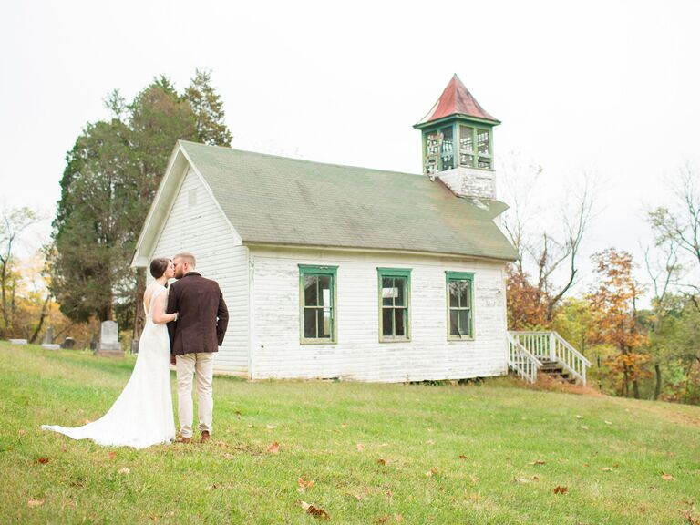couple standing in front of a barn in west virginia