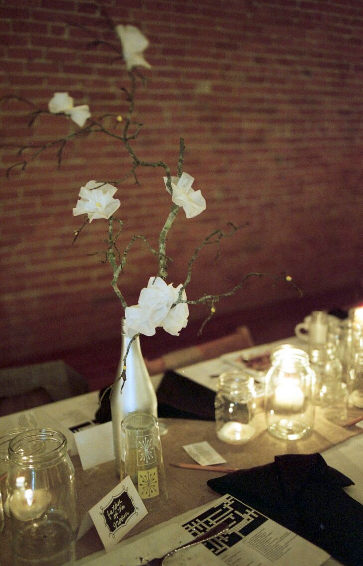 The centerpieces consisted of bottles spray painted silver with white wildflowers. Nelson and Brittany also provided their guests crossword puzzles to fill out.