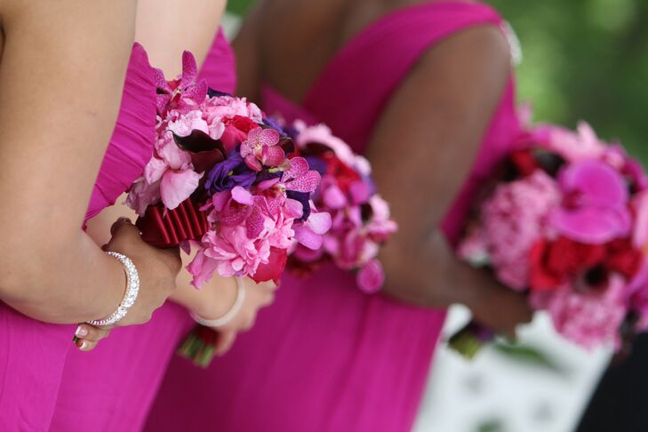 The bridesmaid bouquets contained a mixture of peonies, calla lilies and orchids wrapped in pleated fuchsia fabric.