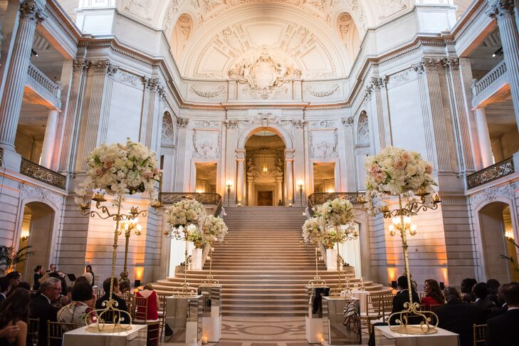 Beth and Eric exchanged vows on the rotunda's staircase, which was lined with white flowers and gold candelabras.