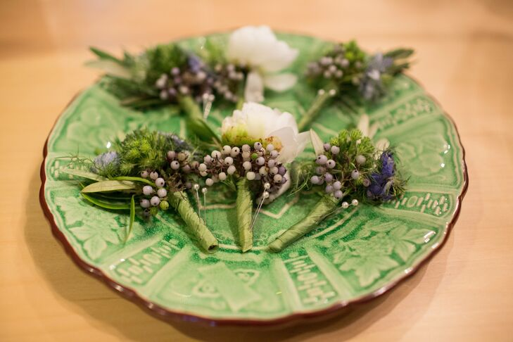 The groomsmen wore French lavender boutonnieres with accents of green hypericum berries and fern while Andy wore a white garden rose with matching pops of berries.
