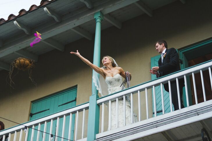 The bride tossed traditional New Orleans beads from the balcony at her reception.