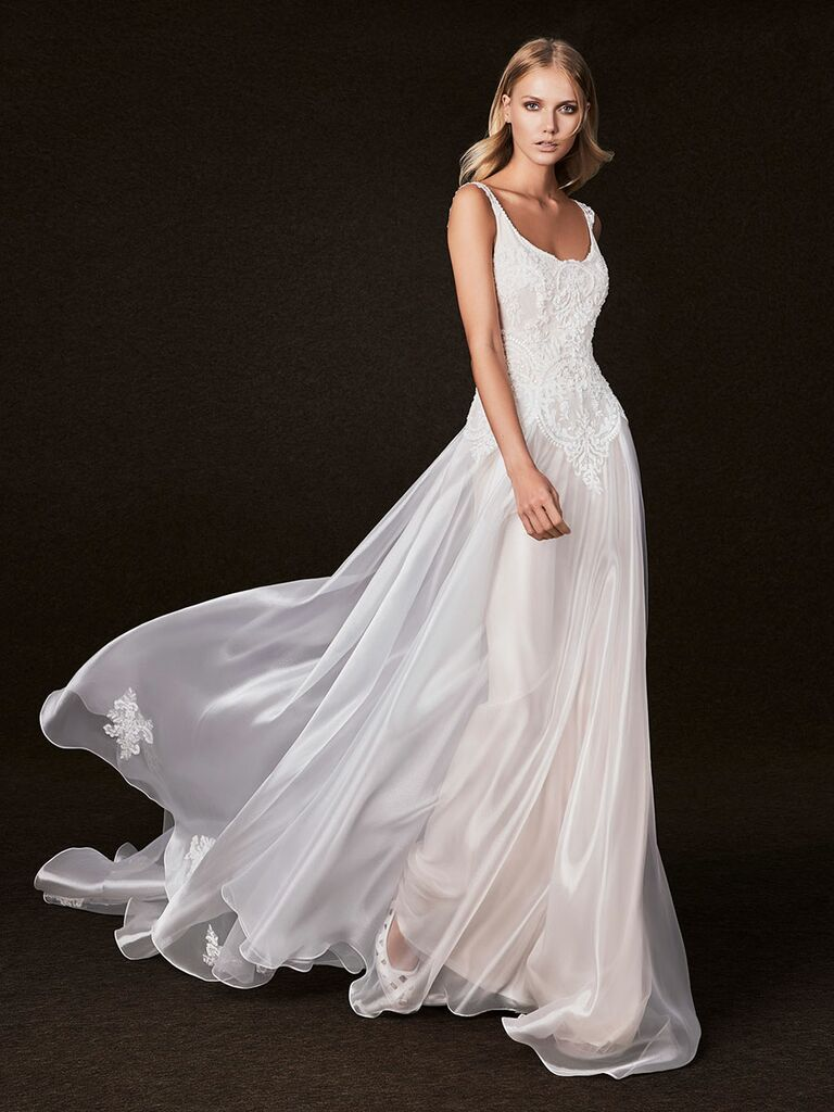 Victoria Kyriakides Fall 2017 scoop neckline with embroidery detialing and flowing organza skirt