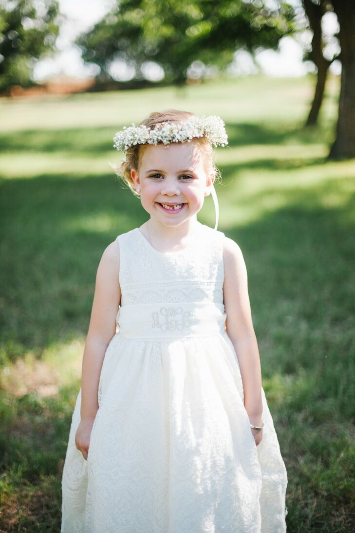 """Claire, the couple's five-year-old flower girl, wore a custom-made dress from Elena Collection on Etsy.com. """"Her monogrammed sash, baby's breath halo and moss basket of rose petals made her look like an angel,"""" recalls Kayla."""