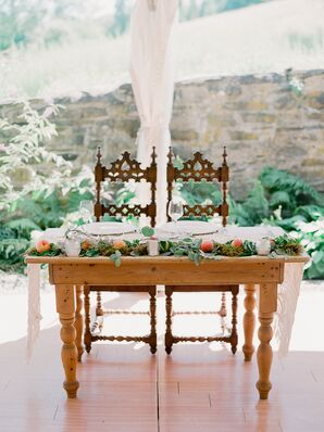 Summery Sweetheart Table with Ornate Chairs and Peach and Greenery Garland