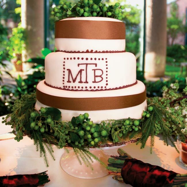 Melissa and Brian cut a small, three-tiered cake covered in ivory fondant and decorated with brown ribbon and polka dots. The cake was mostly for show, however, the real desserts were individual cheesecakes topped off with little flags bearing the couple's monogram.