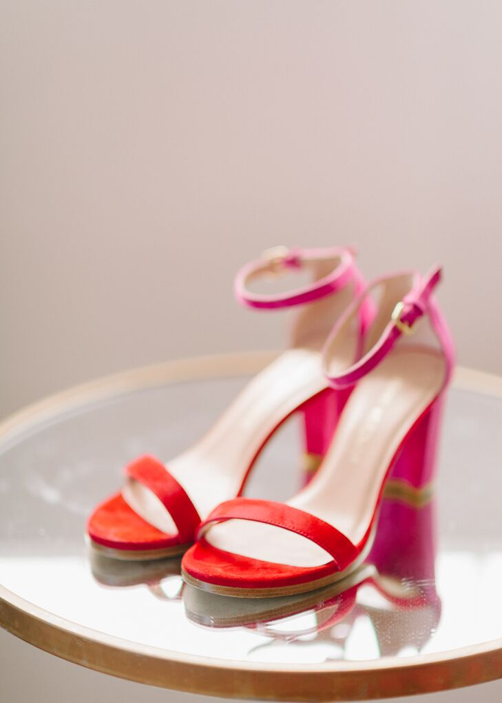 """Jennifer accessorized her Willowby by Watters dress with a pair of pink and red suede Stuart Weitzman heels. """"The hardest items to find were actually my shoes and a reception outfit,"""" Jennifer says. """"I wanted my shoes to make a statement. I love an over-the-top shoe, and I wanted to find one for my wedding. Most important, I wanted my shoes to be comfortable. I was determined to spend my whole wedding night with my shoes on my feet."""""""