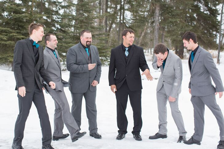 The groomsmen wore their own three-piece gray suits with black shirts and blue ties. rn
