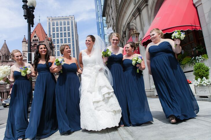 """Stephanie's bridesmaids held bouquets of bright green blooms, which stood out again their floor-length navy gowns. """"The rest of the wedding was very elegant,"""" Stephanie says. """"But this was a way to incorporate something a little different and fun."""""""