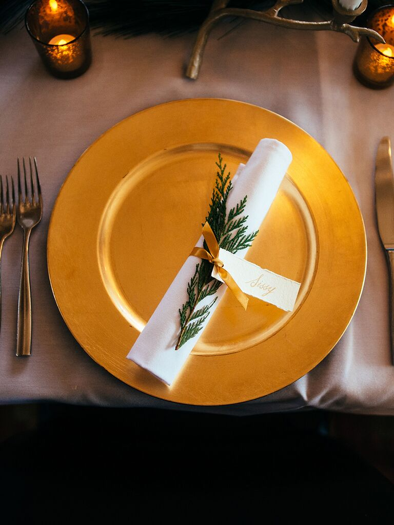 Elegant place setting with evergreen branches