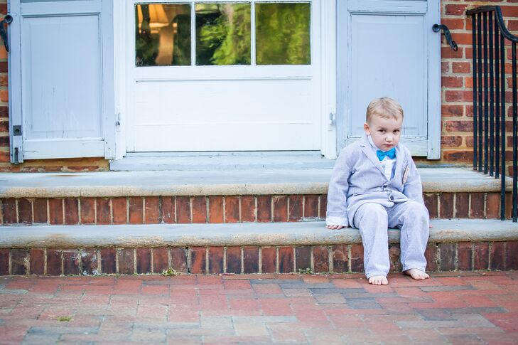 The couple's ring bearer wore an adorable blue seersucker suit, perfect for their garden affair.