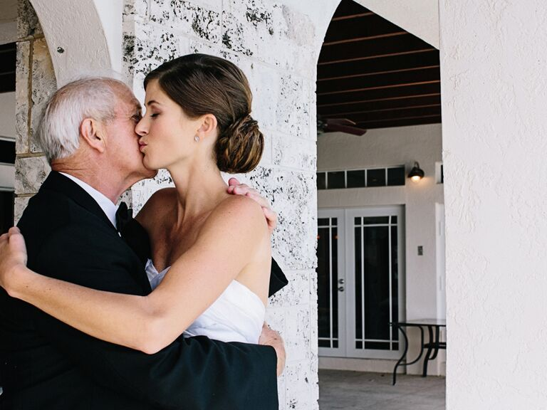 Father of the bride hug before wedding ceremony