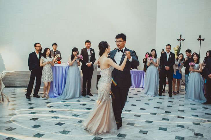 Dongli and Chengyuan took their first dance as a married couple in front of their guests inside Legion of Honor in San Francisco, California. Dongli changed into a champagne-colored dress accented in crystals for the reception.