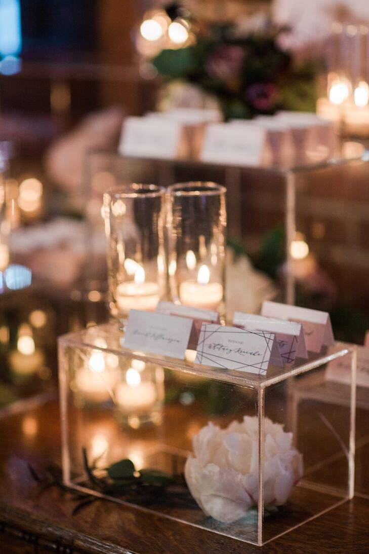 Escort Cards on Top of Glass Cases