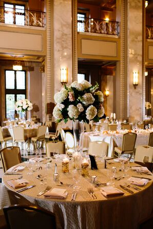 Tall Clear Centerpieces with White Peonies and Greenery