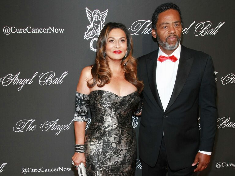 Tina Knowles and Richard Lawson pose at an event