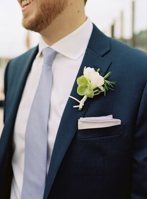 Sweet Pea Boutonniere Against Navy Suit