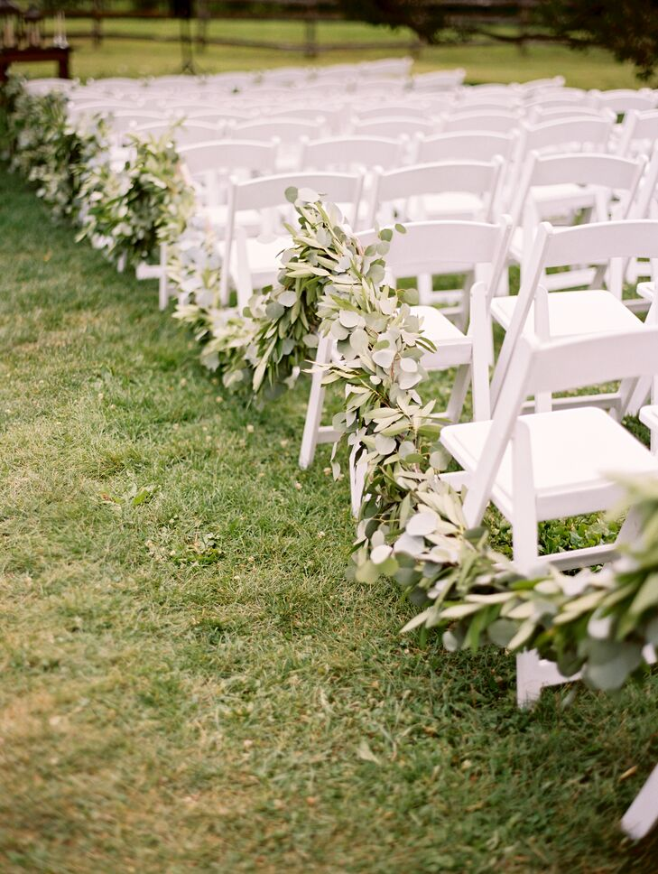 Lush green garlands of eucalyptus and olive leaves lined the ceremony aisle. Each garland was repurposed for the reception, adding a fresh, organic touch to the tabletops.