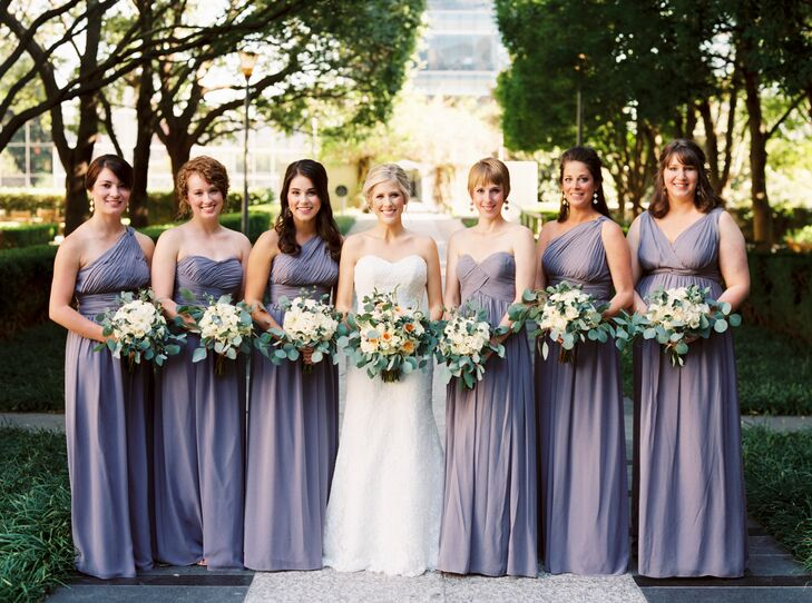 64999c828b2d18 The bridesmaids wore floor-length dresses in lavender and carried  asymmetrical bouquets of eucalyptus and