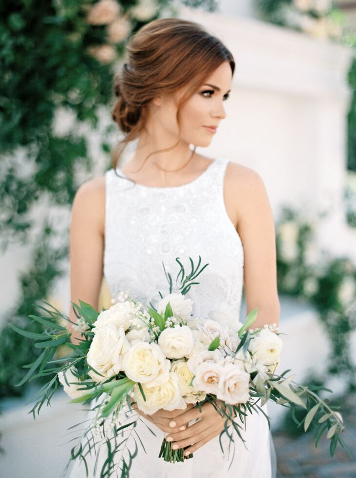 Elegant bridal updo with an organically styled bouquet
