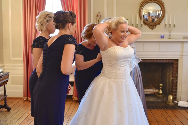 Erika wore a strapless ball gown dress with a sweetheart neckline and beading throughout the bodice on her wedding day.