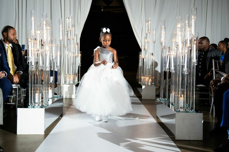 Flower girl in white-and-silver dress