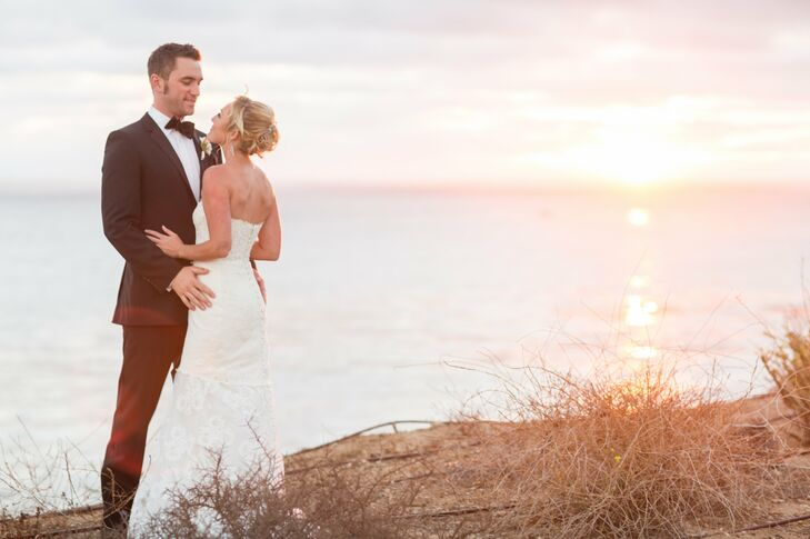 Bride and Groom by the Ocean as the Sun Sets