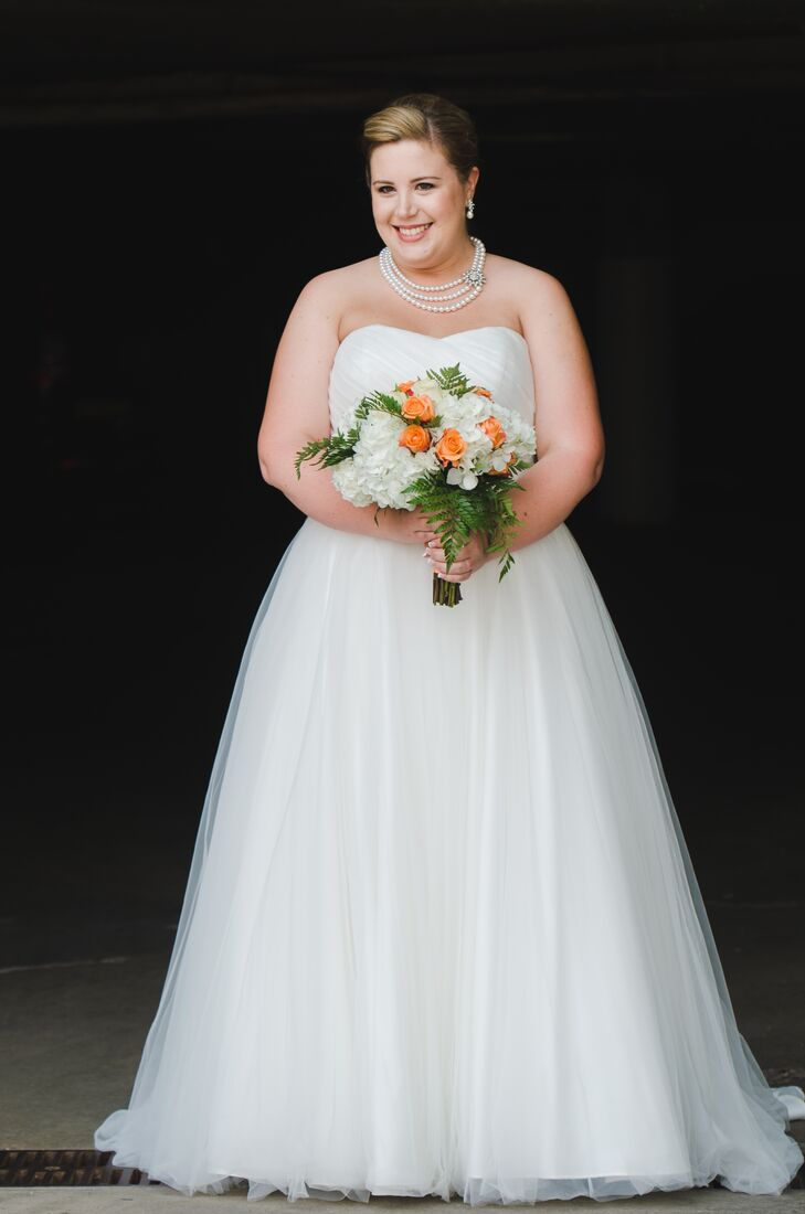 Holly wore a strapless ruched bodice tulle ball gown from David's Bridal.