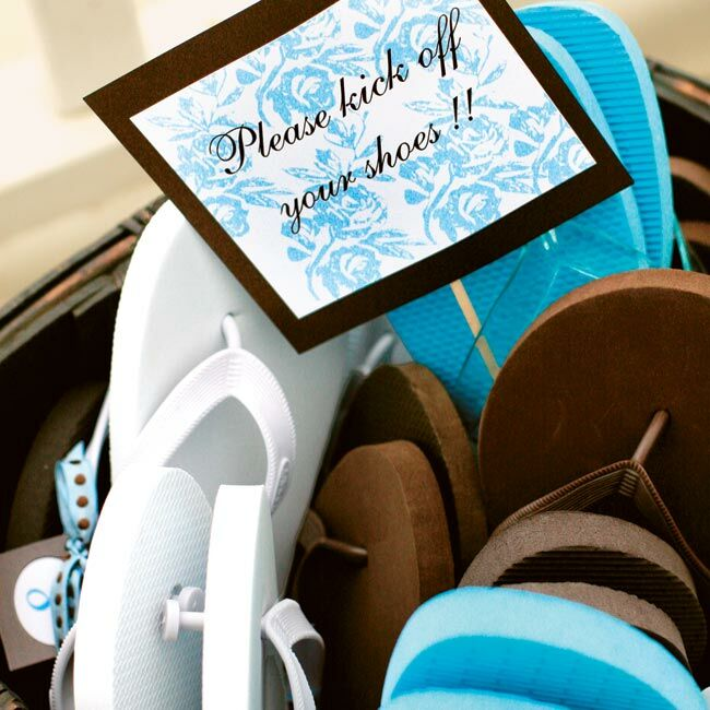 Flip-flops in the wedding's signature colors were available for guests at the ceremony and by the dance floor.