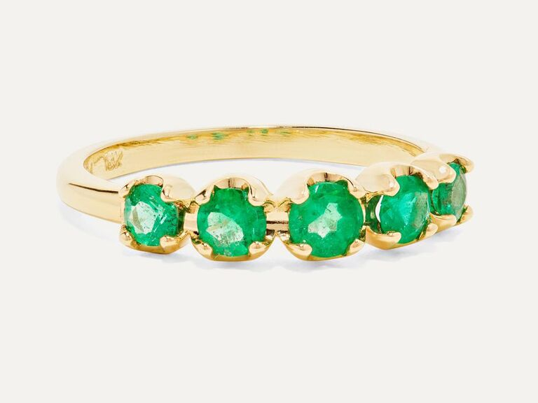 Emerald engagement ring on gold band