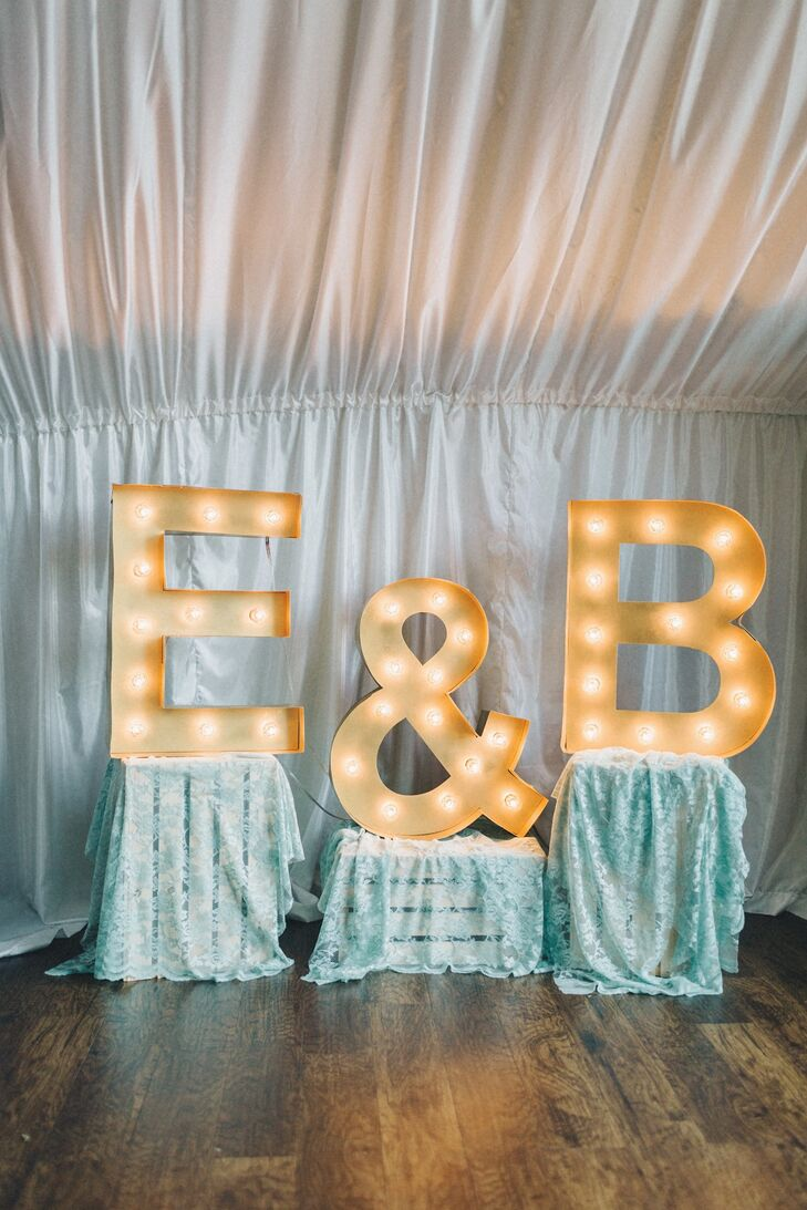 Large light up letters were displayed on top of lace covered wooden boxes and added a vintage glam touch to the decor.