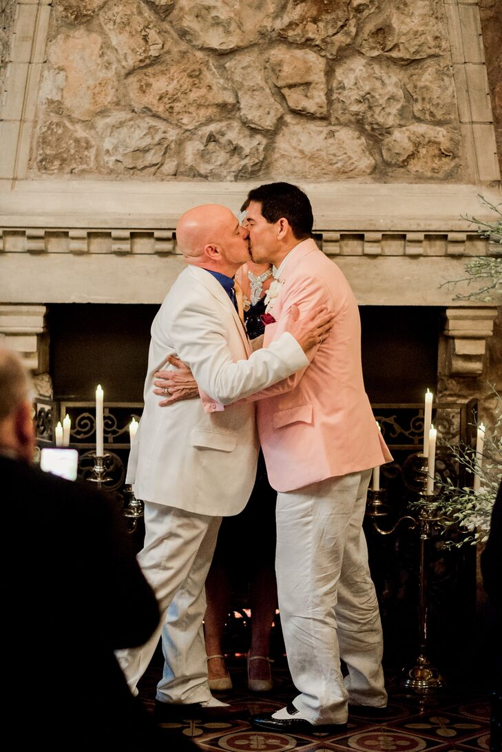 """Ken and Pat asked their close friend (who had introduced them) to officiate, which gave their ceremony a highly personalized and intimate feel. While the couple donned formal tuxedoes for the reception, they opted for more low-key attire for the ceremony. Ken wore a tan linen suit, while Pat completed his """"I do"""" look with a pale pink jacket. """"Our wedding ceremony outfits were custom linen suits to match the fashion of the 1920s,"""" Ken says. """"We didn't have bridesmaids or groomsmen in our wedding, but we requested our guests arrive in 1920s attire."""""""