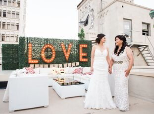 """With the downtown Los Angeles skyline as their backdrop, Iyan(34 and a financial and payroll officer) and Kate (32 and self-employed) said """"I do"""" in"""
