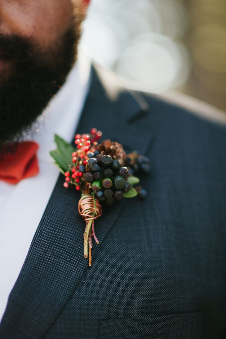 Viburnum dentatum berries and red berries mixed with sprigs of holly made up Nik's boutonniere. The bright colors of the arrangement popped nicely with the surrounding winter environment.
