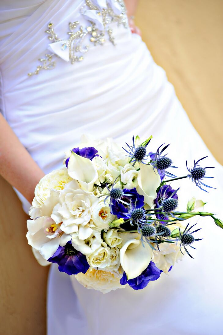 Staci's blue and white bouquet featured a variety of flowers including gardenias, calla lilies and orchids.