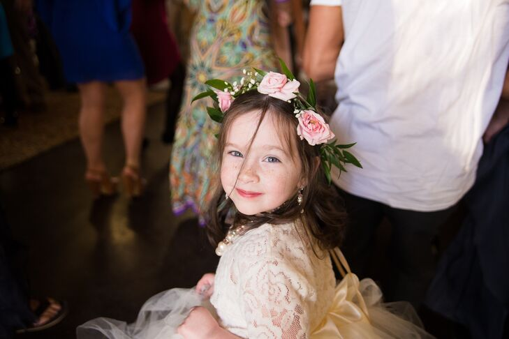 "The flower girls wore ivory tutu dresses made by Tricia's friends. ""They were adorable and the blush pink flower halos made it even more precious,"" says Tricia."
