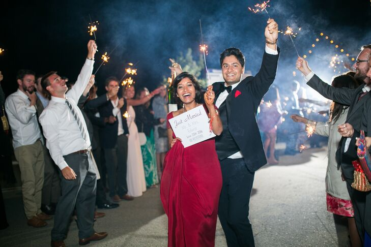 Couple Waving Sparklers During Exit with Guests