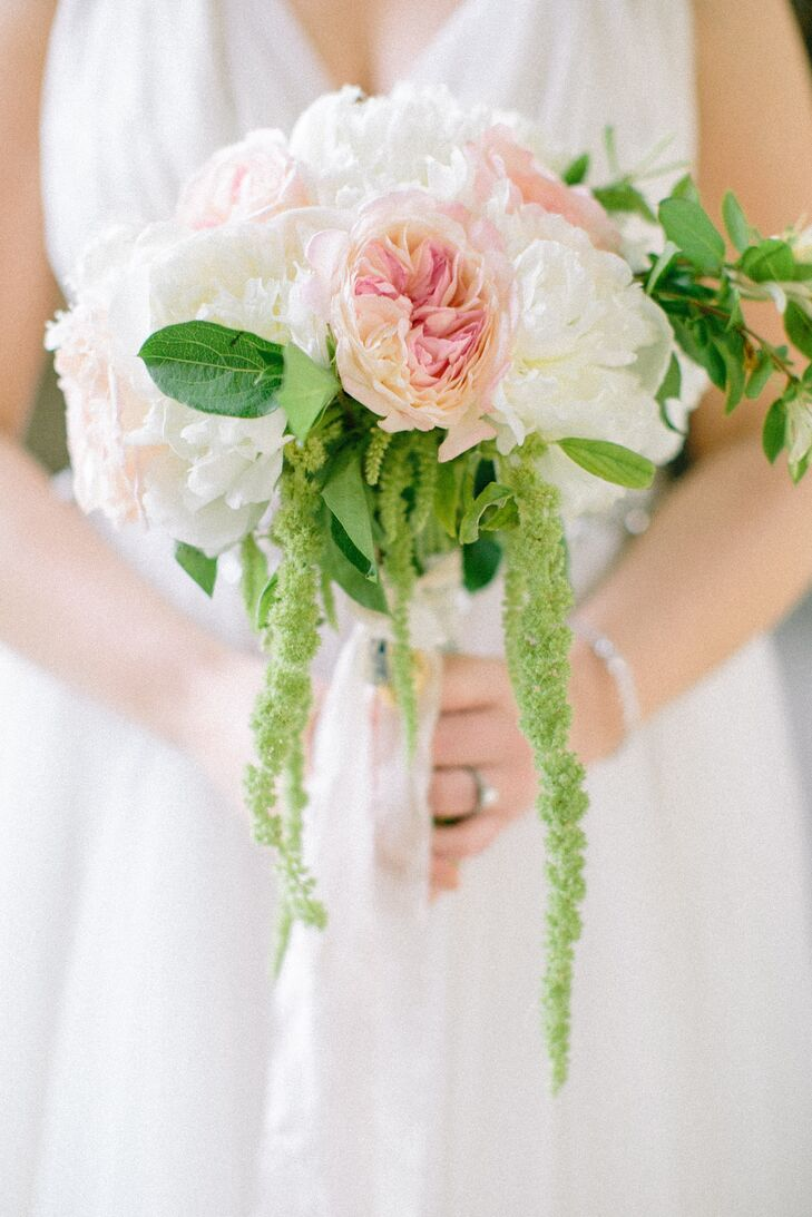 Tara carried a hand-tied bouquet of fluffy white peonies,  David Austin garden roses, blush garden roses, honeysuckle and hanging amaranthus.