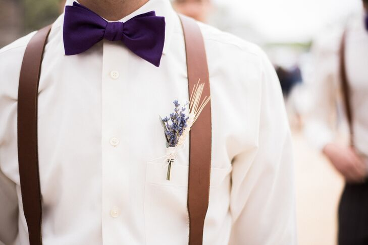 Ryan's gift to the groomsmen were the brown leather suspenders and purple bow ties they wore with gray slacks. Their DIY boutonnieres included lavender and wheat.