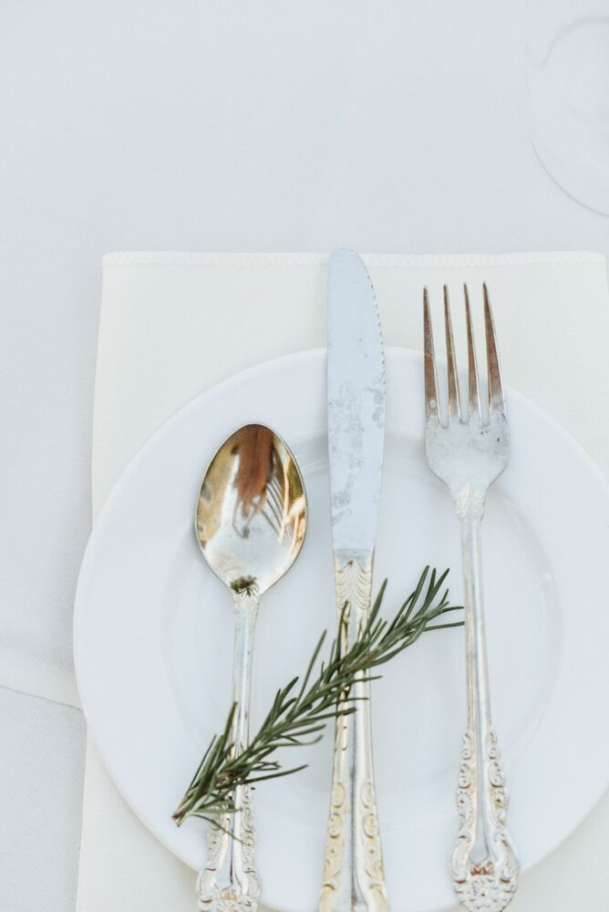 A simple rosemary sprig added an elegant, simple touch to the place settings.