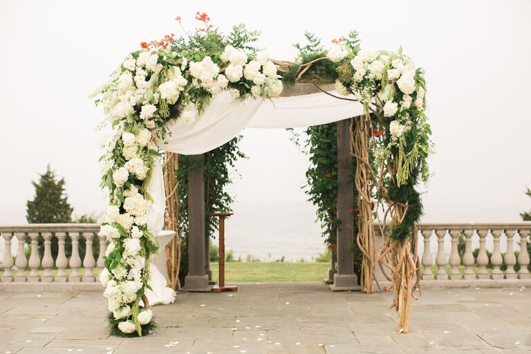 23 creative wedding chuppah ideas we love romantic opulent floral chuppah junglespirit Gallery
