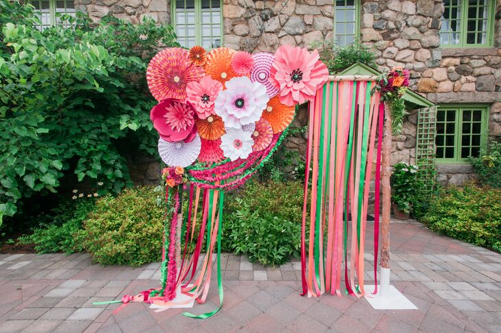 Whimsical Paper Flower And Ribbon Wedding Arch
